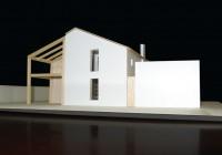 Plastico con vista di casa e garage